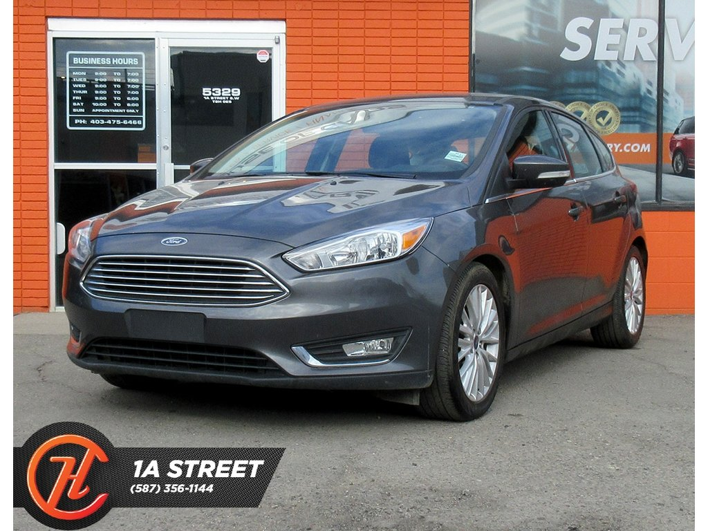Pre-Owned 2018 Ford Focus Titanium/BACKUP CAM/ HEATED SEATS/SUNROOF/MORE