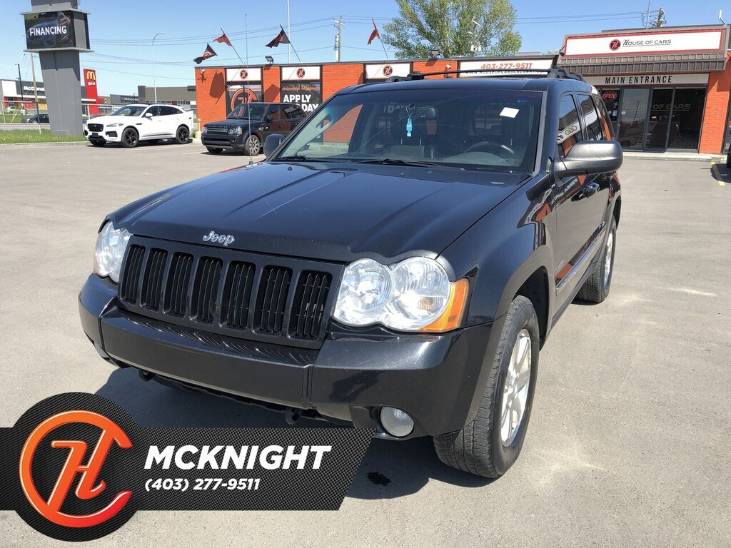 Pre-Owned 2010 Jeep Grand Cherokee Laredo / Sunroof