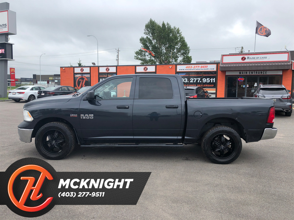Pre-Owned 2014 Ram 1500 4WD Crew Cab 140.5 ST