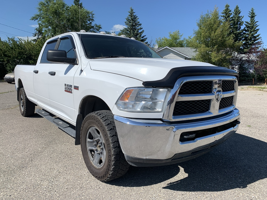 Pre-Owned 2014 Ram 2500 4WD Crew Cab 169 SLT