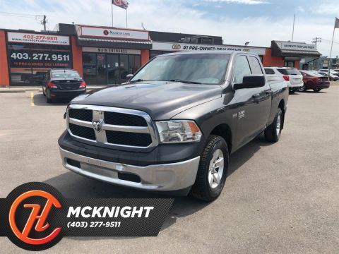 Pre-Owned 2014 Ram 1500 4WD Quad Cab 140.5 ST